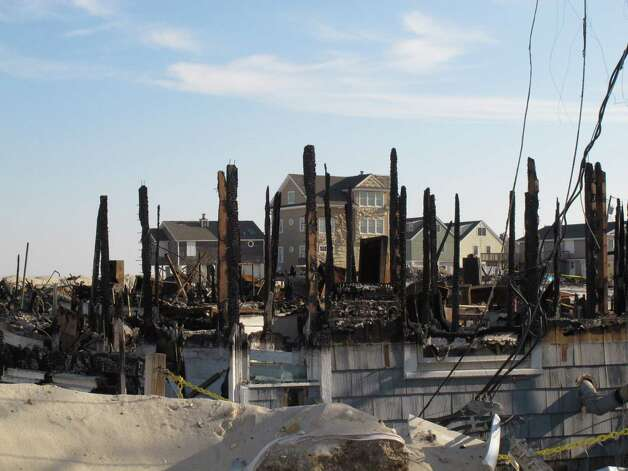 In this Nov. 29, 2012 photo, charred beams and metal are all that remain of some of the more than 100 homes near the beach in Brick, N.J., that were destroyed in a massive fire touched off by Superstorm Sandy. Clearing the rubble and rebuilding the area is one of many challenges facing the Jersey Shore as it recovers from the storm. (AP Photo/Wayne Parry) Photo: Wayne Parry