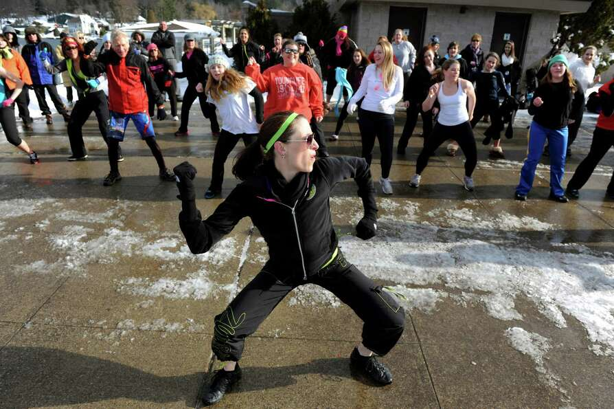 Lisa Camp of Inner Light Yoga, center, leads a Zumba class before the annual Polar Bear Plunge on Tu