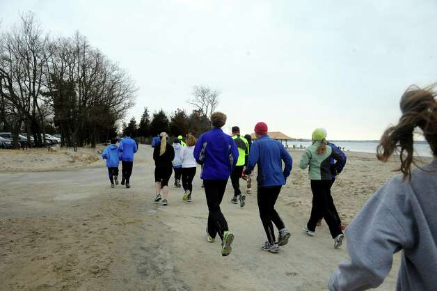 "A group of people go for a run before the first annual ""I Took the Plunge for Kids"" polar plunge to benefit Kids in Crisis, to run, jump or dunk their heads under the freezing water at Tod's Point in Old Greenwich, Conn., Tuesday, Jan. 1, 2013. All proceeds from the event will go to Kids in Crisis. Photo: Helen Neafsey / Greenwich Time"