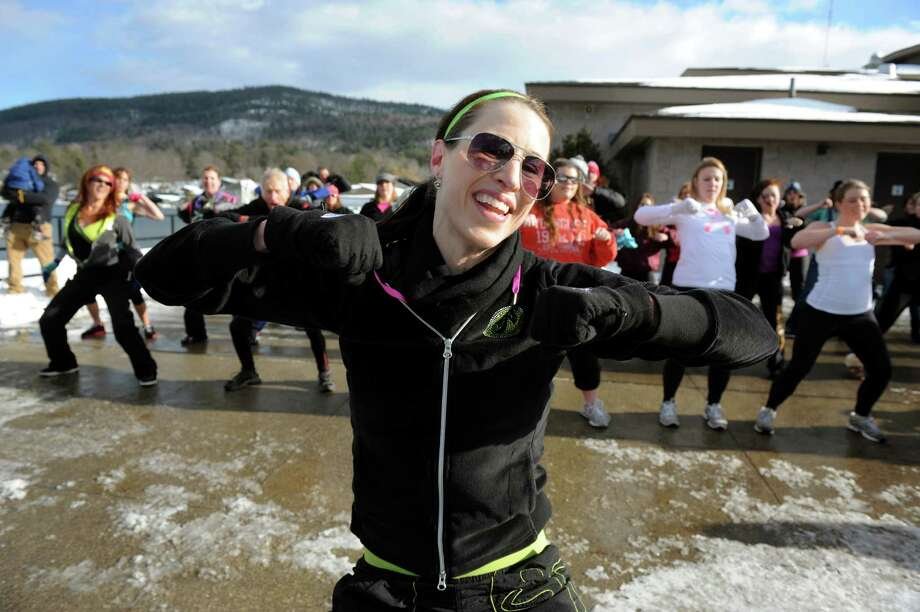 Lisa Camp of Inner Light Yoga, center, leads a Zumba class before the annual Polar Bear Plunge on Tuesday, Jan. 1, 2013, at Million Dollar Beach in Lake George, N.Y. (Cindy Schultz / Times Union) Photo: Cindy Schultz / 00020600A