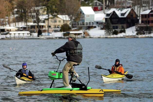 Kayakers and other water enthusiasts are on hand to witness the annual Polar Bear Plunge on Tuesday, Jan. 1, 2013, at Million Dollar Beach in Lake George, N.Y. (Cindy Schultz / Times Union) Photo: Cindy Schultz / 00020600A