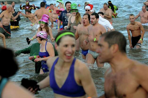 Participants take the annual Polar Bear Plunge on Tuesday, Jan. 1, 2013, at Million Dollar Beach in Lake George, N.Y. (Cindy Schultz / Times Union) Photo: Cindy Schultz / 00020600A