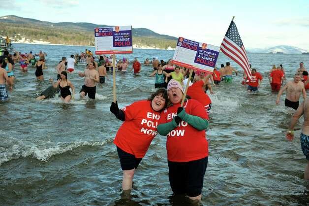 Participants pose for their cause during the annual Polar Bear Plunge on Tuesday, Jan. 1, 2013, at Million Dollar Beach in Lake George, N.Y. (Cindy Schultz / Times Union) Photo: Cindy Schultz / 00020600A