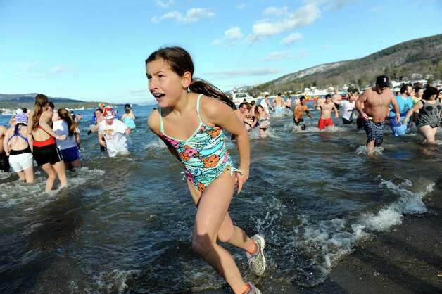 A participants runs back to shore during the annual Polar Bear Plunge on Tuesday, Jan. 1, 2013, at Million Dollar Beach in Lake George, N.Y. (Cindy Schultz / Times Union) Photo: Cindy Schultz / 00020600A