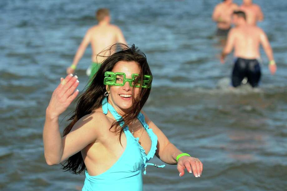 "A participant seems to motion ""come in the water's fine"" during the annual Polar Bear Plunge on Tuesday, Jan. 1, 2013, at Million Dollar Beach in Lake George, N.Y. (Cindy Schultz / Times Union) Photo: Cindy Schultz / 00020600A"