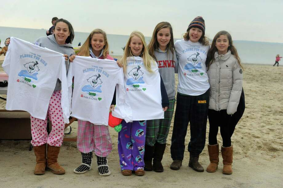 "From the left: Courtney Swift, 12, Lucy Saleeby 12, Eva Moore, 11, Caitlin Chisholm, 12, Allie Moore, 14, and Sofia Zajee, 11, getting ready the first annual ""I Took the Plunge for Kids"" polar plunge to benefit Kids in Crisis, to run, jump or dunk their heads under the freezing water at Tod's Point in Old Greenwich, Conn., Tuesday, Jan. 1, 2013. All proceeds from the event will go to Kids in Crisis. Photo: Helen Neafsey / Greenwich Time"