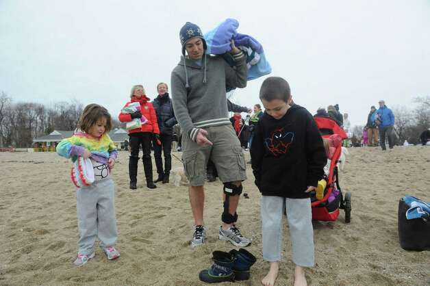 "Tessa Murphy, 4, her father Eli, and son Eli, 7, get ready for the first annual ""I Took the Plunge for Kids"" polar plunge to benefit Kids in Crisis, to run, jump or dunk their heads under the freezing water at Tod's Point in Old Greenwich, Conn., Tuesday, Jan. 1, 2013. All proceeds from the event will go to Kids in Crisis. Photo: Helen Neafsey / Greenwich Time"