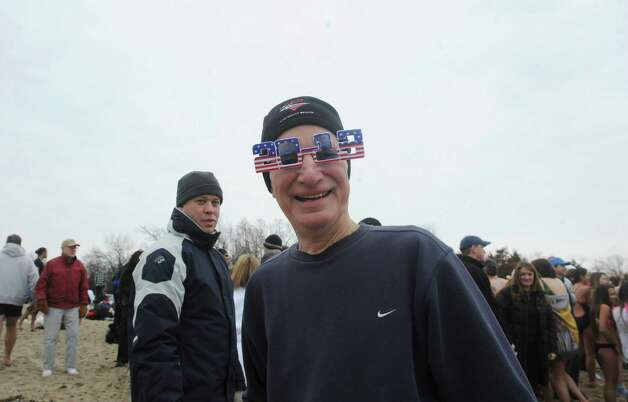 "John Cook show off his 2013 sunglassesThe first annual ""I Took the Plunge for Kids"" polar plunge to benefit Kids in Crisis, to run, jump or dunk their heads under the freezing water at Tod's Point in Old Greenwich, Conn., Tuesday, Jan. 1, 2013. All proceeds from the event will go to Kids in Crisis. Photo: Helen Neafsey / Greenwich Time"