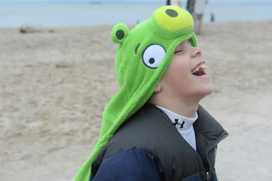 "Randall Feda, 8, at the first annual ""I Took the Plunge for Kids"" polar plunge to benefit Kids in Crisis, to run, jump or dunk their heads under the freezing water at Tod's Point in Old Greenwich, Conn., Tuesday, Jan. 1, 2013. All proceeds from the event will go to Kids in Crisis. Photo: Helen Neafsey / Greenwich Time"