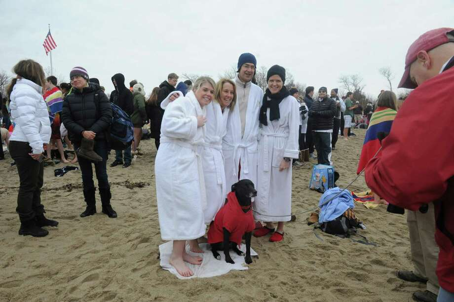 "From left, Jessica McCluskey, Christine Sikes, John Burke, Patty Burke and dog, Deacon Sikes getting ready for at the first annual ""I Took the Plunge for Kids"" polar plunge to benefit Kids in Crisis, to run, jump or dunk their heads under the freezing water at Tod's Point in Old Greenwich, Conn., Tuesday, Jan. 1, 2013. All proceeds from the event will go to Kids in Crisis. Photo: Helen Neafsey / Greenwich Time"