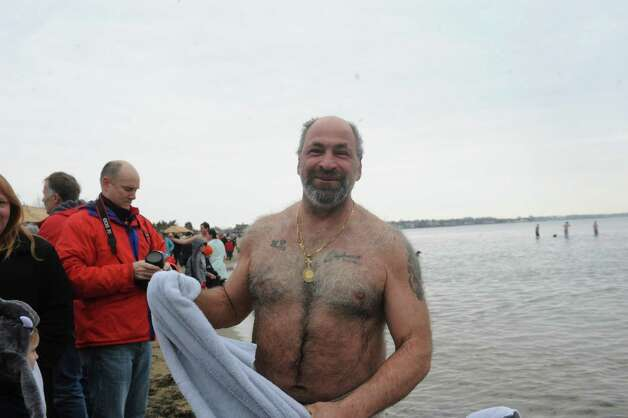 "Maro Viola, of Greenwich, at the first annual ""I Took the Plunge for Kids"" polar plunge to benefit Kids in Crisis, to run, jump or dunk their heads under the freezing water at Tod's Point in Old Greenwich, Conn., Tuesday, Jan. 1, 2013. All proceeds from the event will go to Kids in Crisis. Photo: Helen Neafsey / Greenwich Time"