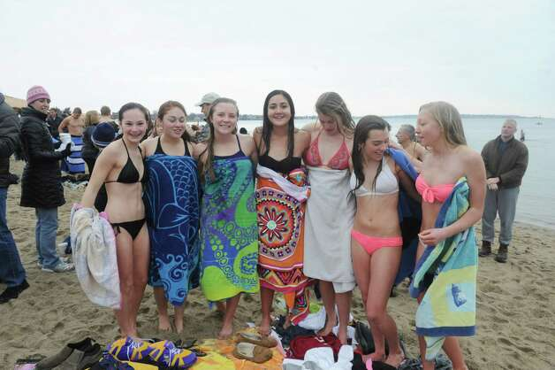 "Girls get ready for the first annual ""I Took the Plunge for Kids"" polar plunge to benefit Kids in Crisis, to run, jump or dunk their heads under the freezing water at Tod's Point in Old Greenwich, Conn., Tuesday, Jan. 1, 2013. All proceeds from the event will go to Kids in Crisis. Photo: Helen Neafsey / Greenwich Time"