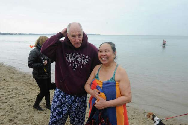 "Ed Morre and his wife Waree at the first annual ""I Took the Plunge for Kids"" polar plunge to benefit Kids in Crisis, to run, jump or dunk their heads under the freezing water at Tod's Point in Old Greenwich, Conn., Tuesday, Jan. 1, 2013. All proceeds from the event will go to Kids in Crisis. Photo: Helen Neafsey / Greenwich Time"