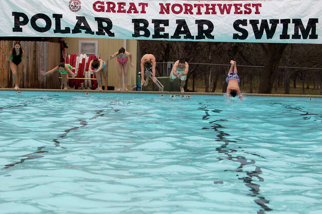 FOR METRO - Swimmers dive into the pool during the 22nd Annual Polar Bear Swim for the Great Northwest Neighborhood Association at Silver Creek Pool on Tuesday, Jan. 1, 2013. The first swim was January 1, 1991. MICHAEL MILLER / FOR THE EXPRESS-NEWS Photo: Michael Miller, For The Express-News  / San Antonio Express-News