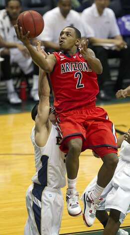 Arizona guard Mark Lyons is a work in progress, but the team he leads is ranked third in the nation. Photo: Eugene Tanner, Associated Press