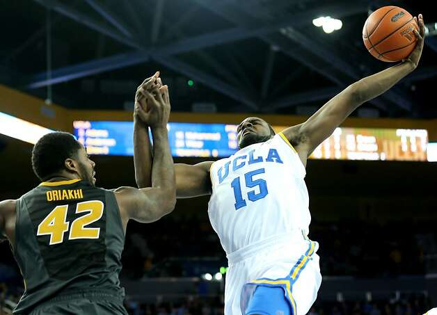 LOS ANGELES, CA - DECEMBER 28: Shabazz Muhammad of the UCLA Bruins goes up for a shot over Alex Oriakhi #42 of the Missouri Tigers at Pauley Pavilion on December 28, 2012 in Los Angeles, California.  UCLA won 97-94 in overtime.  (Photo by Stephen Dunn/Getty Images) Photo: Stephen Dunn, Getty Images