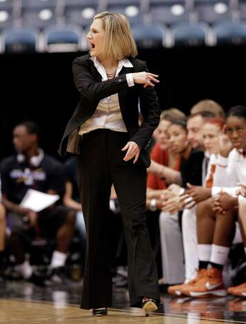 Coach Karen Aston and the Longhorns play their first true road game at Iowa State. Photo: David J. Phillip, Associated Press / AP