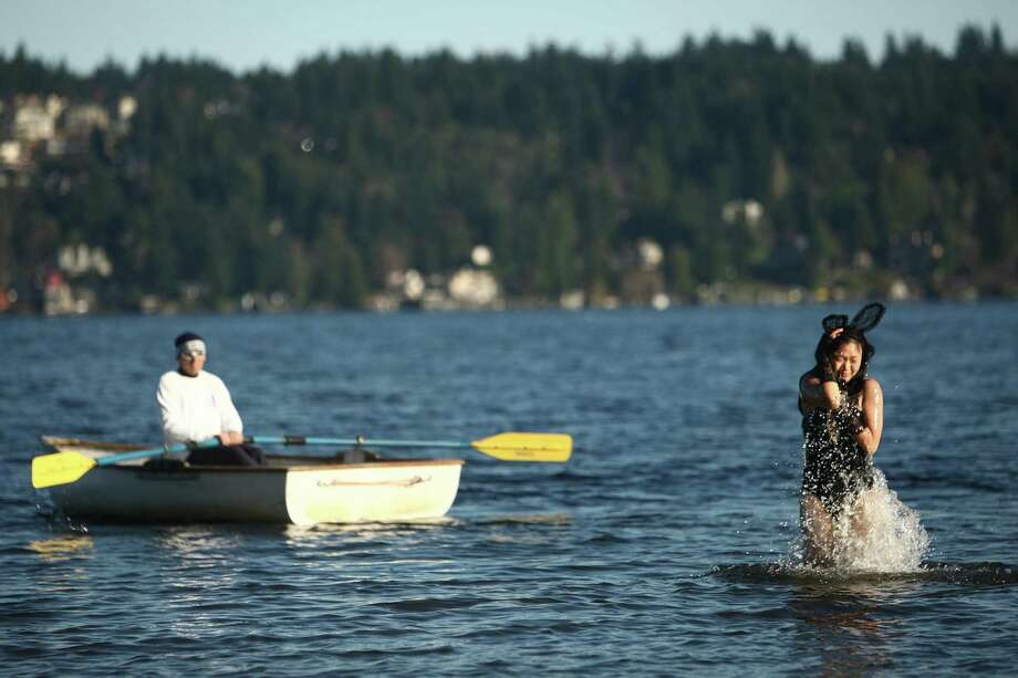 A woman wearing bunny ears hops out of the chilly water of Lake Washington during the 11th annual Polar Bear Plunge at Matthews Beach. Photo: JOSHUA TRUJILLO / SEATTLEPI.COM