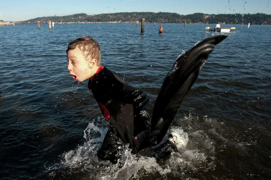 A young participant returns to the beach from the chilly water of Lake Washington during the 11th annual Polar Bear Plunge. Photo: JOSHUA TRUJILLO / SEATTLEPI.COM