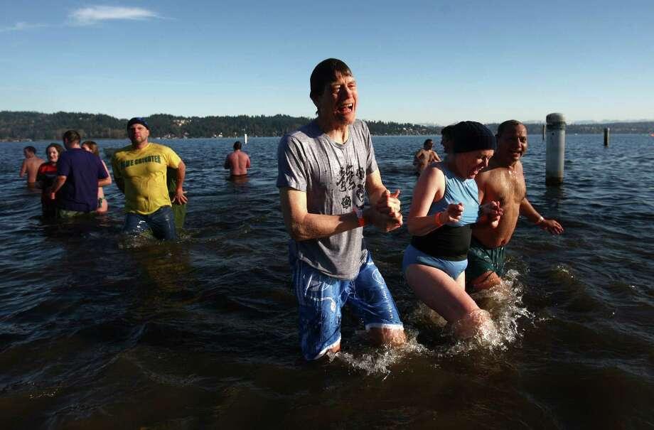 Revelers dip into the chilly water of Lake Washington. Photo: JOSHUA TRUJILLO / SEATTLEPI.COM