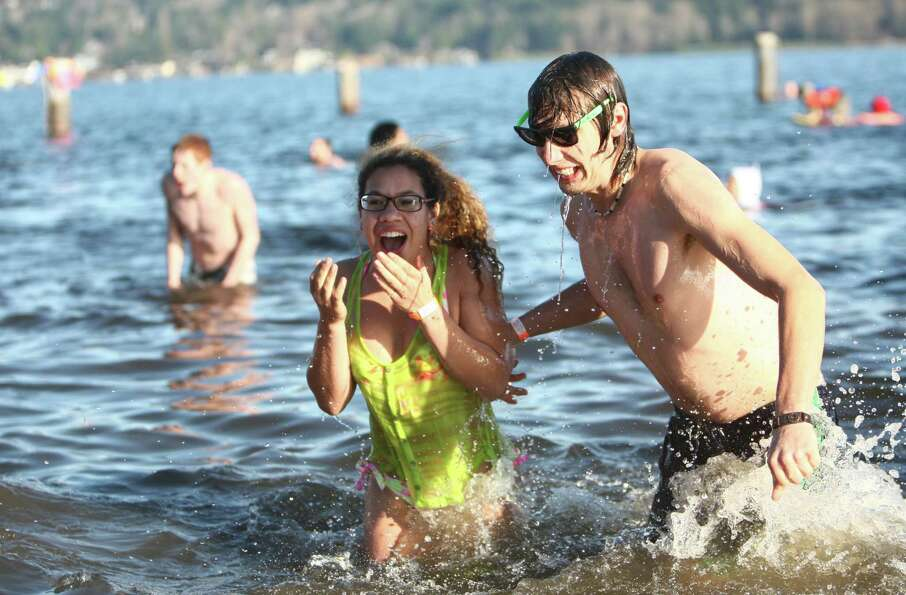 Revelers dip into the chilly water of Lake Washington.