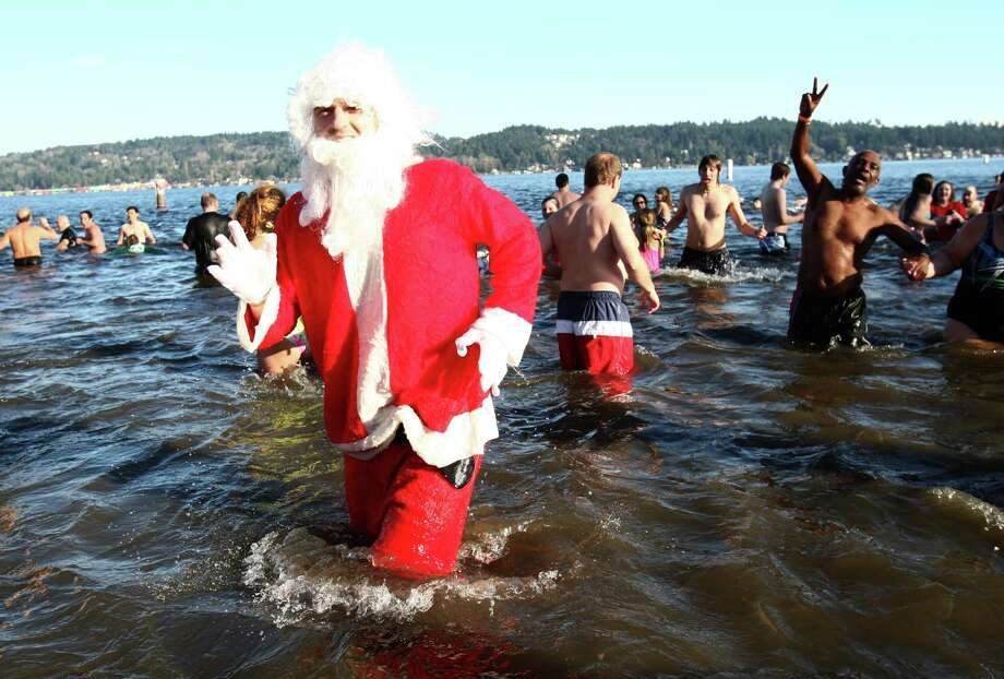 Revelers dip into the chilly water of Lake Washington during the 11th annual Polar Bear Plunge at Matthews Beach. Photo: JOSHUA TRUJILLO / SEATTLEPI.COM