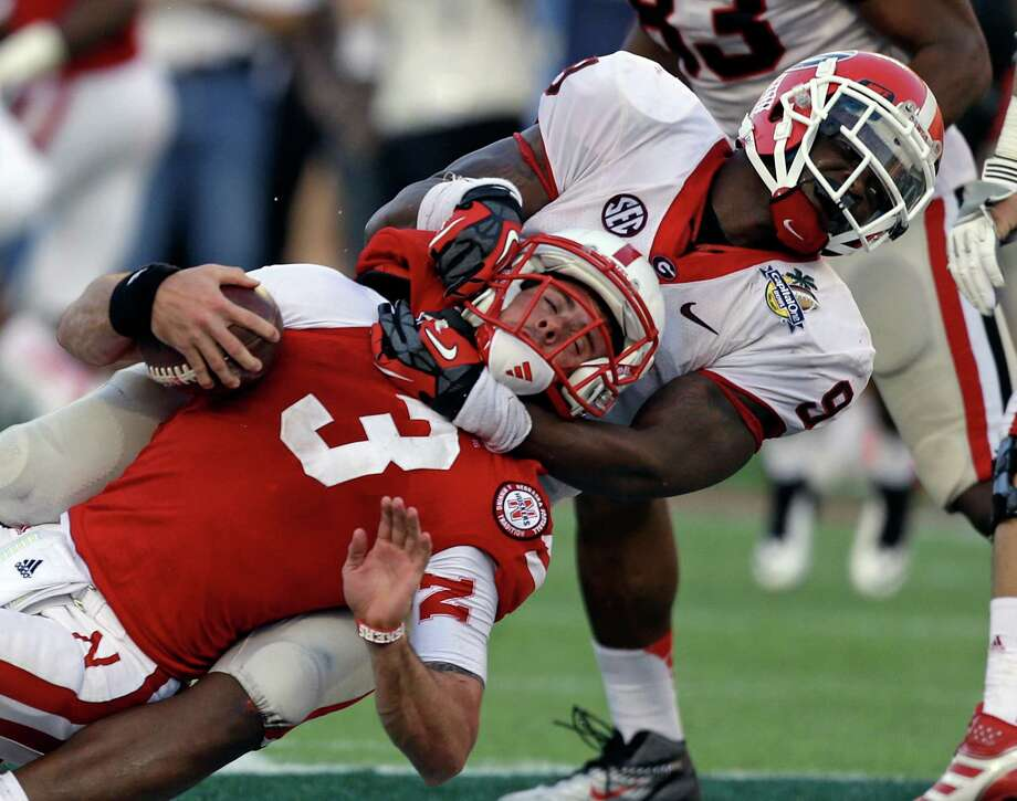 Capital One Bowl, Jan. 1: Georgia 45, Nebraska 31; Florida Citrus Bowl in Orlando, Fla.; Payout: $4,550,000 PHOTO: Georgia linebacker Alec Ogletree (9) sacks Nebraska quarterback Taylor Martinez (3) on a fourth and nine play late in the fourth quarter of the Capital One Bowl. Photo: John Raoux, Associated Press / AP