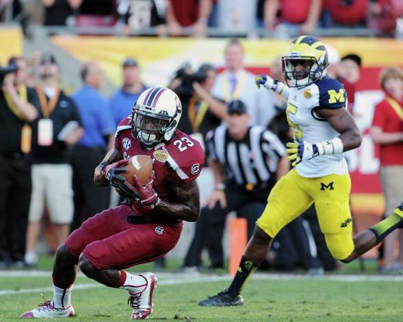Outback Bowl, Jan. 1: South Carolina 33, Michigan 28; Raymond James Stadium in Tampa, Fla.; Payout: $3,500,000 PHOTO: South Carolina wide receiver Bruce Ellington (23) grabs a 32-yard, game-winning touchdown pass in the fourth quarter against Michigan in the Outback Bowl. Photo: Al Messerschmidt, Getty Images / 2013 Getty Images