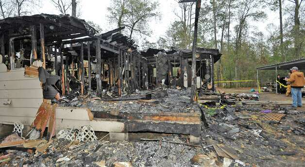 Stephanie and Burt Wales lost their home in a fire on December 21, 2012, that also seriously burned their teenage daughter and killed their three dogs who had woke them up. Now two friends are working to help them rebuild the home because they did not have insurance. On Monday, they were at the home trying to salvage more of their belongings.  Dave Ryan/The Enterprise Photo: Dave Ryan
