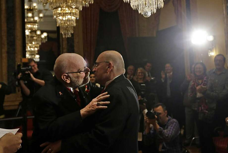 James Scales (left) and William Tasker, a couple for 35 years, kiss after being married by Mayor Stephanie Rawlings-Blake shortly after midnight in Baltimore's City Hall. Photo: Patrick Semansky, Associated Press