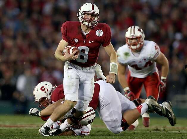 PASADENA, CA - JANUARY 01:  Quarterback Kevin Hogan #8 of the Stanford Cardinal runs the ball in the fourth quarter against the Wisconsin Badgers in the 99th Rose Bowl Game Presented by Vizio on January 1, 2013 at the Rose Bowl in Pasadena, California.  (Photo by Jeff Gross/Getty Images) Photo: Jeff Gross, Getty Images