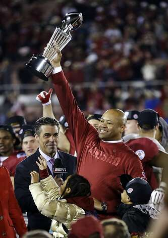 Stanford head coach David Shaw lifts the trophy following their 20-14 win over Wisconsin in the Rose Bowl NCAA college football game, Tuesday, Jan. 1, 2013, in Pasadena, Calif. (AP Photo/Lenny Ignelzi) Photo: Lenny Ignelzi, Associated Press