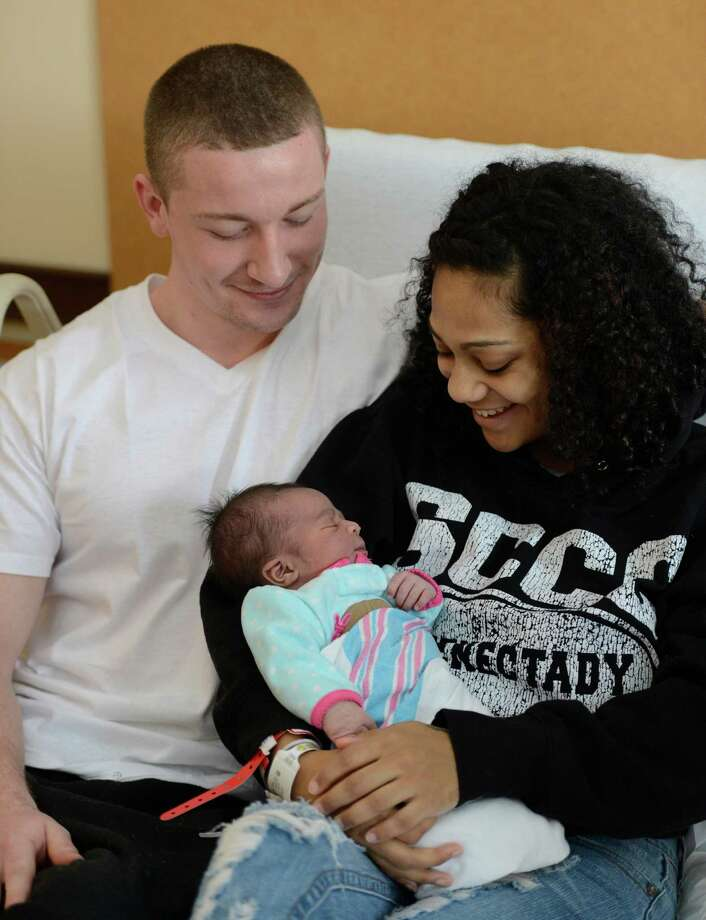 Seth Buess and Martia Higginbotham are the proud parents of the Capital District's first child of 2013  Zaniya Buess who was born at 12:17 am this morning at the Bellvue Women's Center in Niskayuna, N.Y.  Jan 1, 2013. (Skip Dickstein/Times Union) Photo: SKIP DICKSTEIN / 00020628A