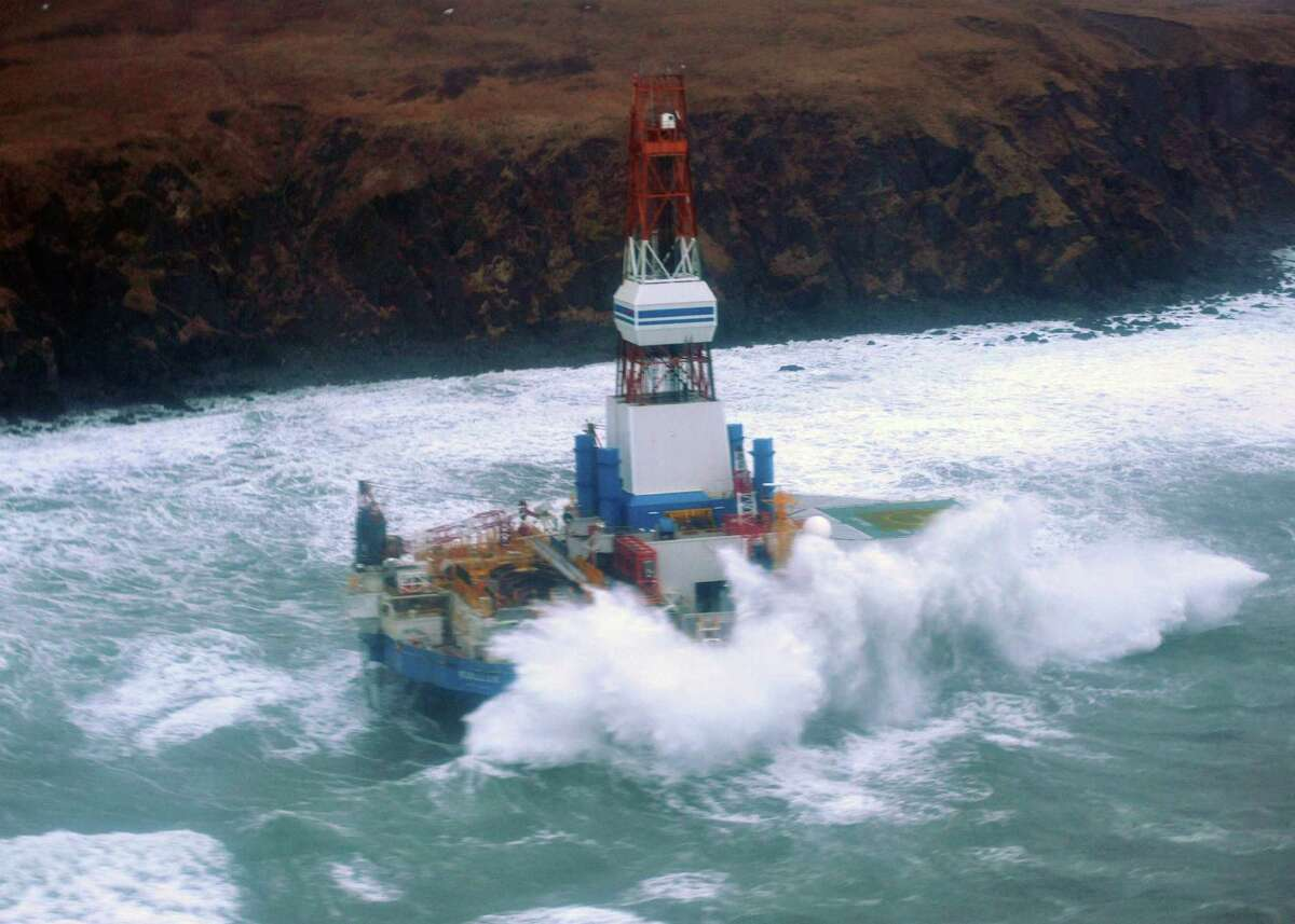 Shell's mobile drilling rig Kulluk sits aground on Sitkalidak Island, Alaska. It was unmanned when it plowed into the rocks.