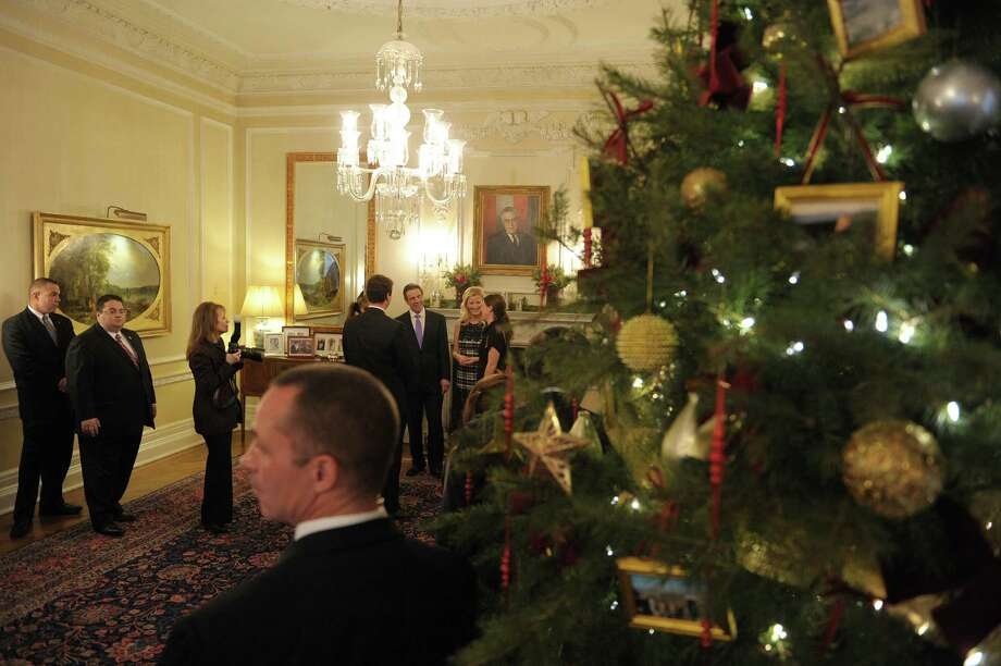 Far background center, Governor Andrew Cuomo and his girlfriend, Sandra Lee meet visitors during an open house at the Executive Mansion on Tuesday, Jan. 1, 2013 in Albany, NY.  Those attending the open house were able to meet the Governor, his girlfriend Sandra Lee and two of the Governor's daughters.   (Paul Buckowski / Times Union) Photo: Paul Buckowski