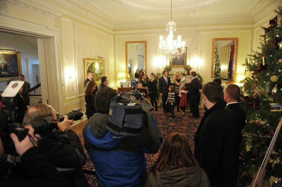 Far background from left to right, Cara Cuomo, her sister, Michaela Cuomo, their father Governor Andrew Cuomo and the  Governor's girlfriend, Sandra Lee meet visitors during an open house at the Executive Mansion on Tuesday, Jan. 1, 2013 in Albany, NY.   (Paul Buckowski / Times Union) Photo: Paul Buckowski