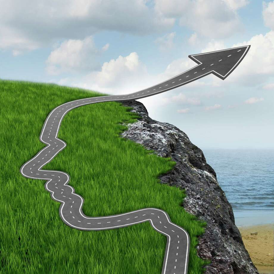 Success and risk and believing in yourself setting your mind free with a highway in the shape of a human head going up as an arrow over a dangerous rock cliff. / freshidea - Fotolia