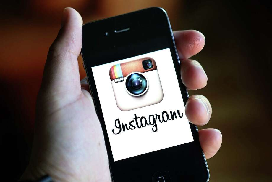 Anger among users of the photo-sharing app Instagram forced the company to halt plans to use client identities and images without permission. Photo: Justin Sullivan, Staff / 2012 Getty Images