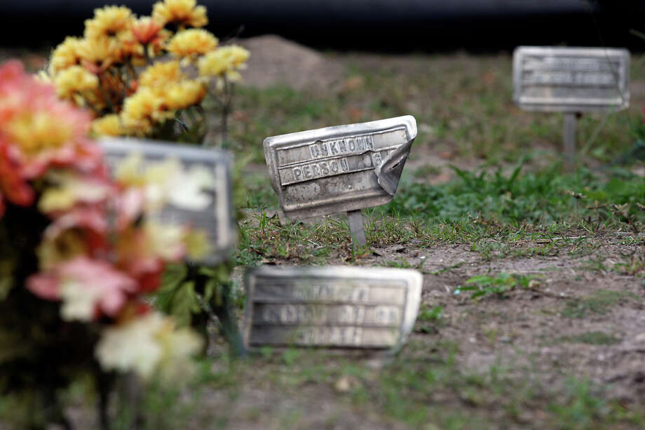 "Plastic flowers mark ""John Doe"" graves in Brooks County, where 127 illegal immigrants were found dead last year. The county has no room or funds to bury more. Photo: Jerry Lara, Staff / © 2012 San Antonio Express-News"
