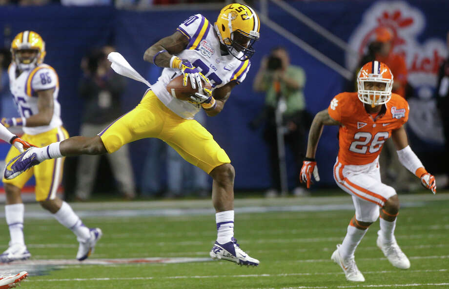 LSU wide receiver Jarvis Landry (80) makes a catch as Clemson defensive back Garry Peters (26) watches during the first half of the Chick-fil-A Bowl NCAA college football game, Monday, Dec. 31, 2012, in Atlanta. (AP Photo/John Bazemore) Photo: John Bazemore