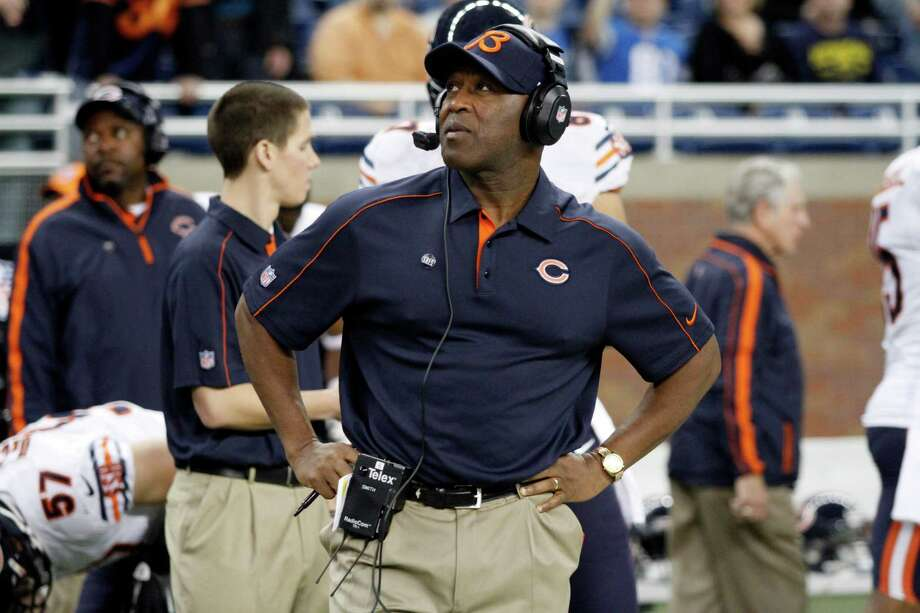 In this Dec. 30, 2012 photo, Chicago Bears head coach Lovie Smith watches from the sidelines during an NFL football game against the Detroit Lions at Ford Field in Detroit. The Chicago Bears fired Smith after nine seasons on Monday, Dec. 31, 2012, parting ways with a coach who led them to a Super Bowl but also oversaw late collapses the past two seasons. The dismissal with one year left on his contract comes after Chicago missed the playoffs for the fifth time in six seasons. (AP Photo/Duane Burleson) Photo: Duane Burleson