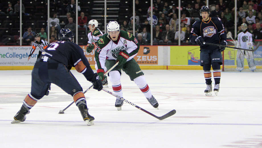 Aeros center Carson McMillan looks to control the puck in Tuesday's win. (Morris Molina/Houston) Aeros
