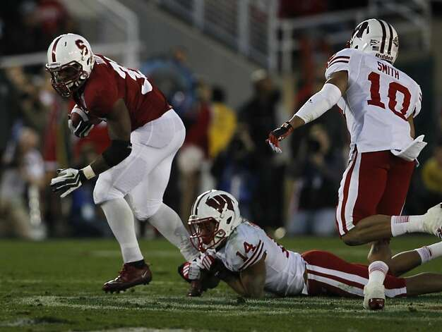 Wisconsin's Marcus Cromartie (14) keeps Stanford's Stepfan Taylor from breaking away for a touchdown in the 4th quarter of the Rose Bowl in Pasadena, Calif. on Tuesday, Jan. 1, 2013. Photo: Paul Chinn, The Chronicle