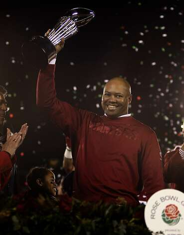 Head Coach David Shaw hoists the Rose Bowl trophy after Stanford beat Wisconsin 20-14 in Pasadena, Calif. on Tuesday, Jan. 1, 2013. Photo: Paul Chinn, The Chronicle