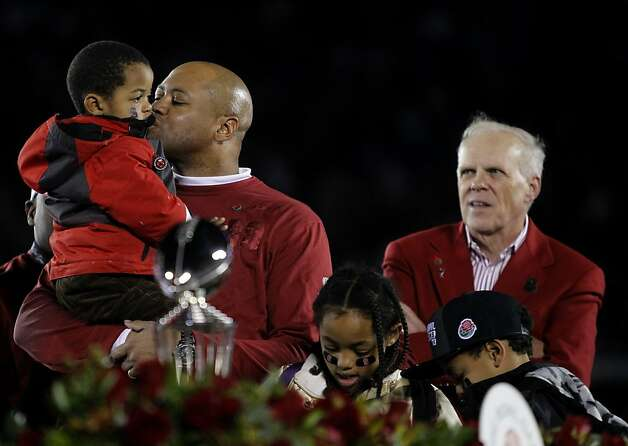 Head Coach David Shaw celebrates Stanford's Rose Bowl victory over the Wisconsin Badgers with his son Gavin (left) daughter Keegan, and son Carter, as well as university president John Hennessy (right) in Pasadena, Calif. on Tuesday, Jan. 1, 2013. Photo: Paul Chinn, The Chronicle