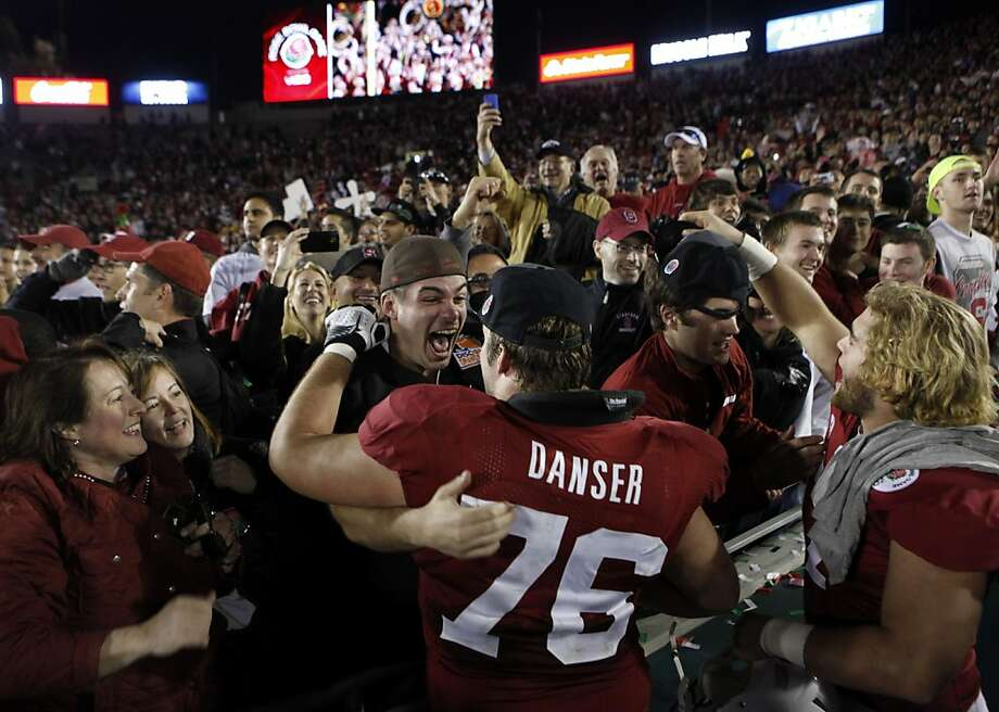 Offensive guard Kevin Danser gets an enthusiastic hug from his brother Tim after Stanford beat the Wisconsin Badgers in the Rose Bowl in Pasadena, Calif. on Tuesday, Jan. 1, 2013. Photo: Paul Chinn, The Chronicle