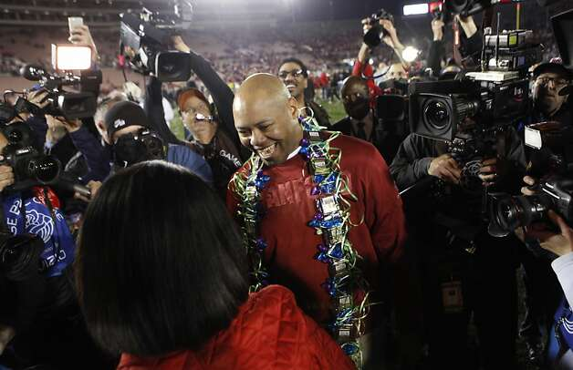 Condoleezza Rice (foreground) congratulates Stanford head coach David Shaw after the win over the Wisconsin Badgers at the Rose Bowl in Pasadena, Calif. on Tuesday, Jan. 1, 2013. Photo: Paul Chinn, The Chronicle