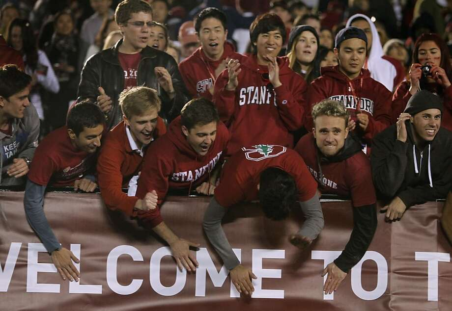 "Stanford fans show their enthusiasm at game's end. About 40,000 Cardinal backers were in attendance, showing they can ""travel well"" for a major bowl. Photo: Paul Chinn, The Chronicle"