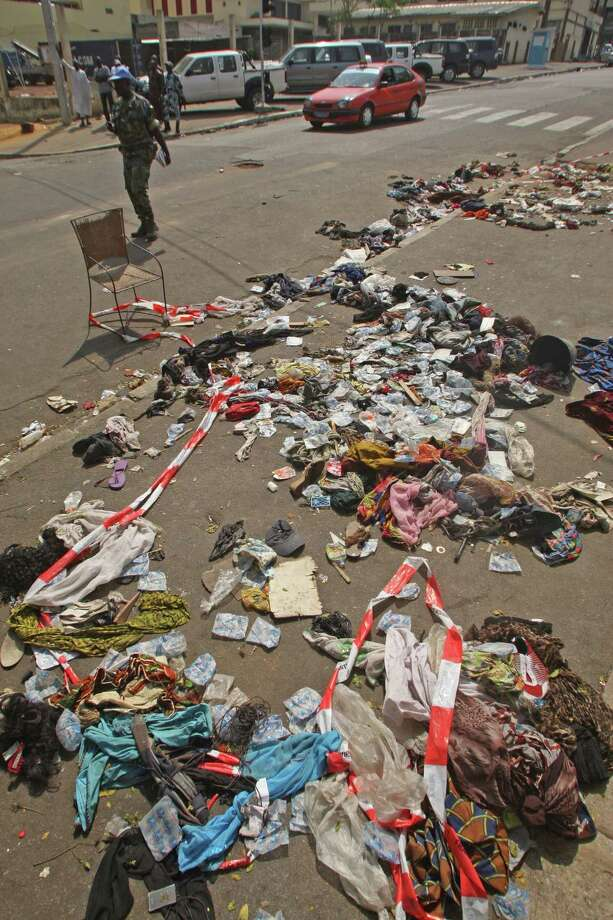 The belongings of people that were involved in a stampe lies on the ground  in Abidjan, Ivory Coast, Tuesday, Jan 1 2013. At least 61 people were killed early Tuesday in a stampede following a New Year's fireworks display in Abidjan, Ivory Coast's commercial center, said officials. The death toll is expected to rise, according to rescue workers. The majority of those killed were young people between eight and 15 years old who were trampled after the fireworks festivities in Abidjan's Plateau district, at about 1 a.m. Tuesday, said Col. Issa Sako, of the fire department rescue team. (AP Photo/Emanuel Ekra) Photo: Emanuel Ekra