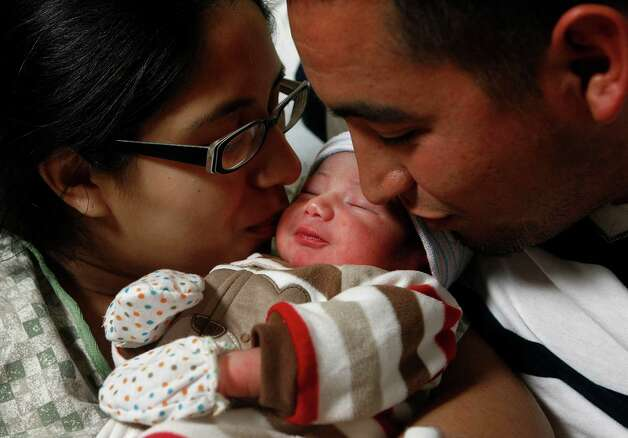 Jesse Cervantez Jr., 21 inches long and weighing 6 pounds and 11 ounces, was born at 30 seconds past midnight. Photo: Johnny Hanson, Staff / © 2012  Houston Chronicle